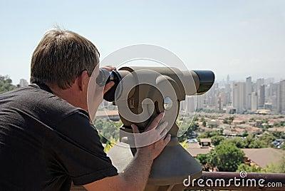 Man Looking Through Viewpoint Telescope.