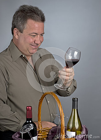 Man Looking at Wine Color