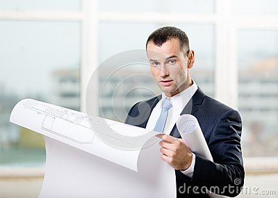 Man looks at blueprint in hands