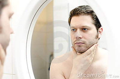 Man looks at his beard