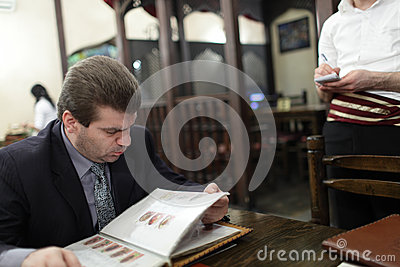Man looks through menu