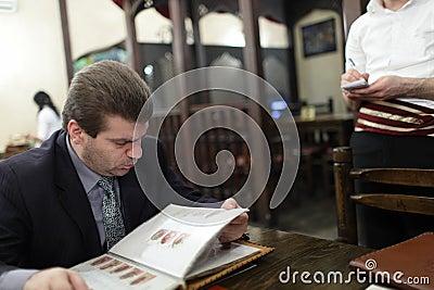 Man looks through menu