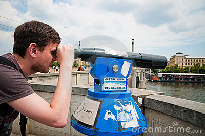 The man looks through telescope