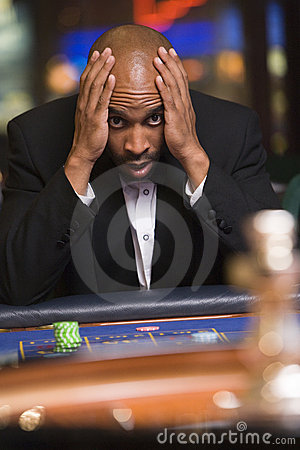 Man losing at roulette table