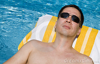 Man lounging by the pool royalty free stock photography for Pool man show