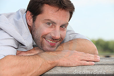 Man lying on bench