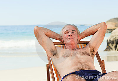 Man lying down in his deck chair