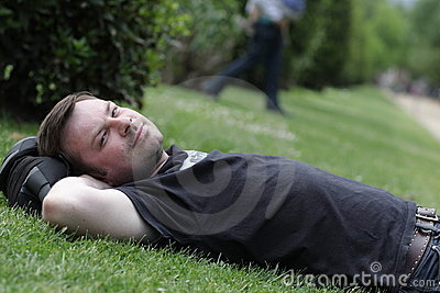 Man is lying on grass