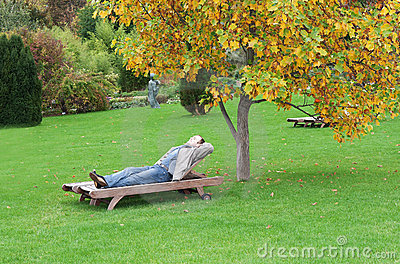 A man, lying on a lounger