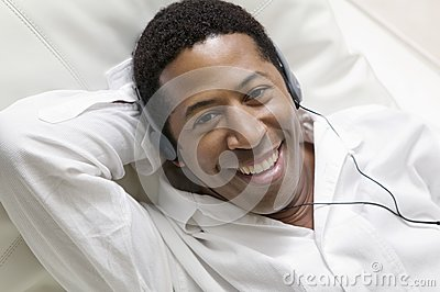 Man lying on sofa Listening to Music