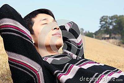 Man lying in yellow grass