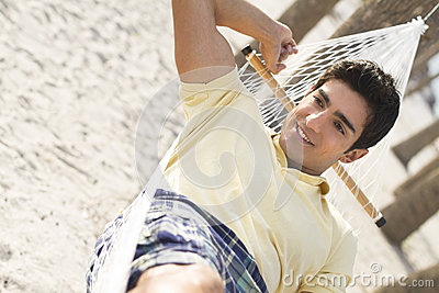 Man lyning in a hammock