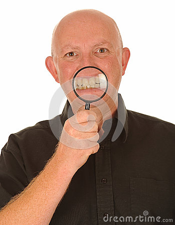 Man with magnifier on teeth
