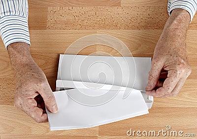 Man mailing letter in white envelope