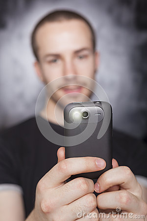 Man make photo with smartphone, focus on phone