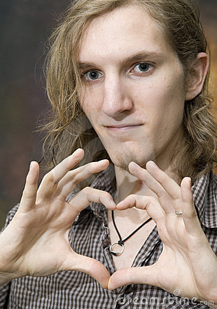 Man making heart shape with hands