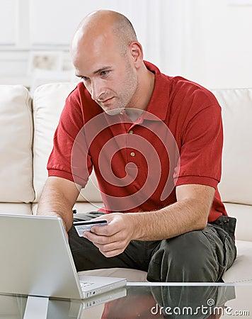 Man making online purchase on laptop