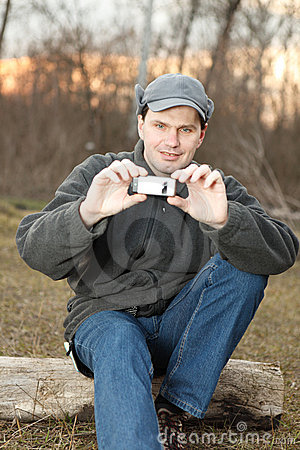 Man making photo with mobile phone