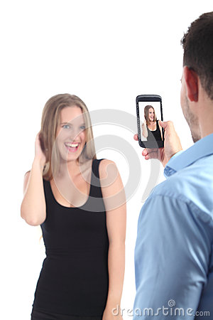 Man making photograph of a girl with a mobile phone