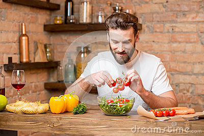 Man making salad Stock Photo