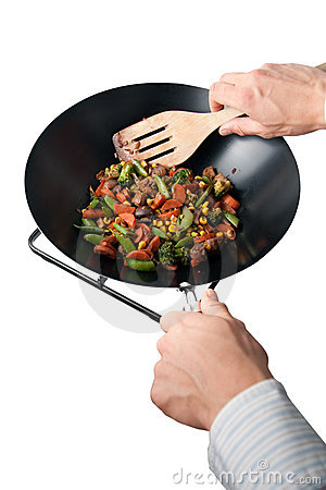 Man making wok food