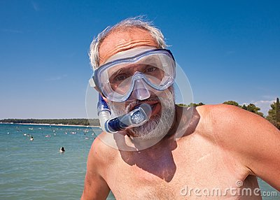 A man with a mask and snorkel