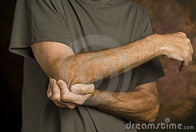 Man massaging elbow in pain_2