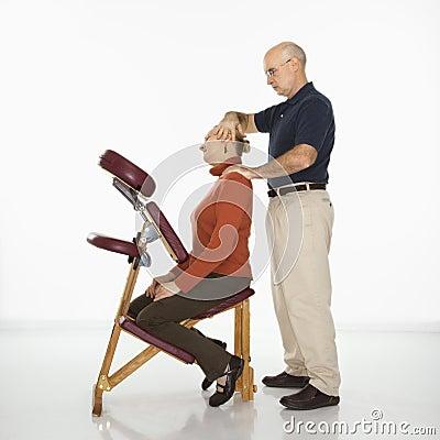 Man massaging woman.
