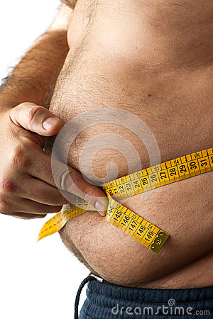A man  measuring his belly fat