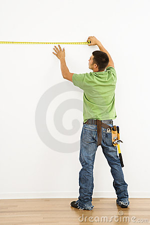 Free Man Measuring Wall. Royalty Free Stock Images - 3532979
