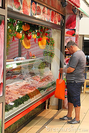 Man buying fresh meat Editorial Stock Photo