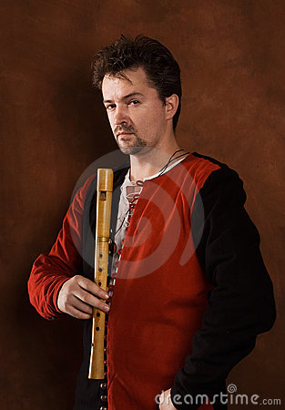 Man in a medieval suit whit a flute