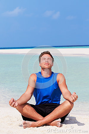 Man Meditating On Beautiful Beach