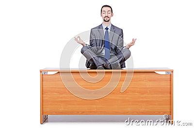Man meditating on the desk