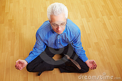 Man Meditating In Living Room Stock Photos - Image: 12821813