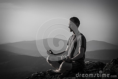 Man meditation on a rock