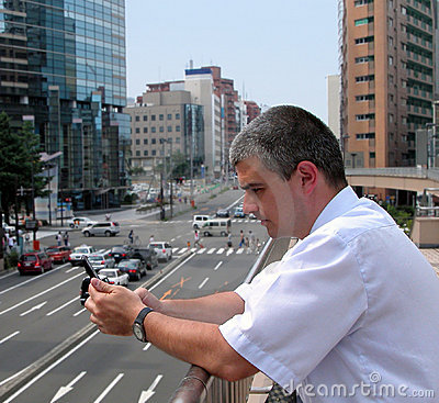 Man with mobile phone in a city