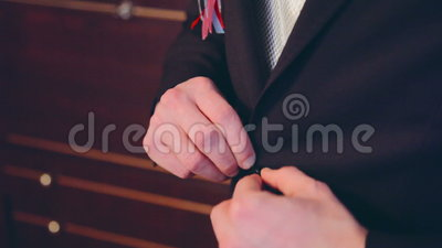 Man model putting on a jacket and going out. In full HD stock video footage