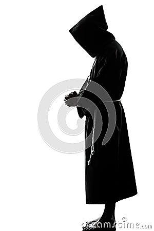 Man monk priest silhouette praying
