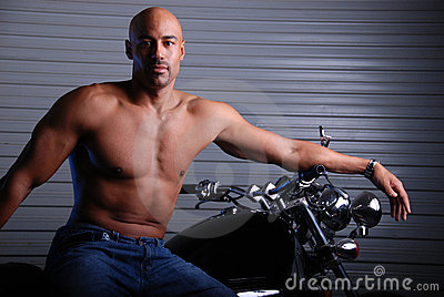 Man and motor cycle.