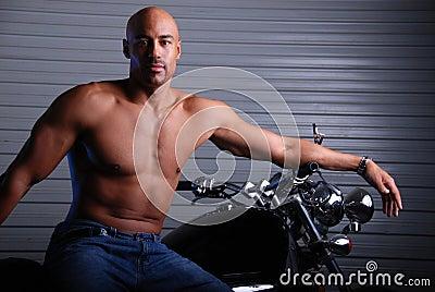 Man and motor cycle.