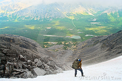 Man in mountain standing on peak