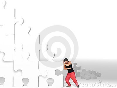 Man Moving Big Puzzle Pieces
