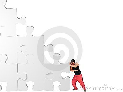 Man moving jigsaw pieces