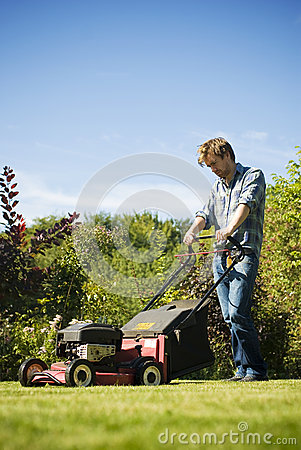 Free Man Mowing Lawn Royalty Free Stock Image - 30474906