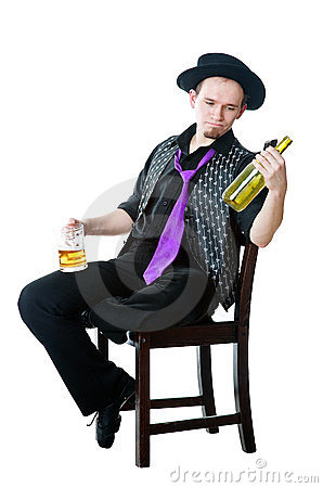 Man with mug of beer and empty bottle