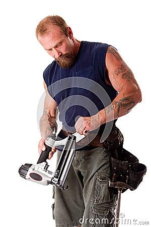 Man with nail gun