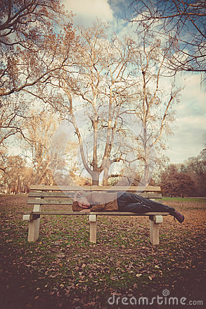 Man Napping on a Bench