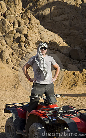 Man near ATV in desert