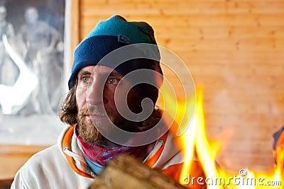 A man near a fire
